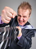 Business confrontation. Businessman taking you by the tie and punching Stock Photography