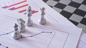 Business confrontation battle make by national chess royalty free stock images