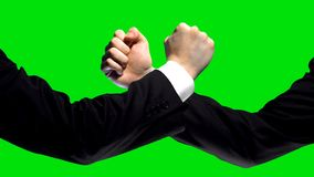 Business confrontation, fists on green screen background, market competition. Stock photo stock photos