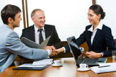 Business consensus. Photo of business partners holding hands making a consensus stock photography