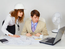 Business construction industry team looking on laptop Stock Images