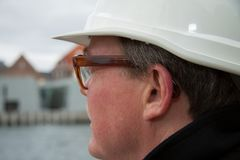Business construction man ingineer architect on the work site overlooking project at waterfront stock photos