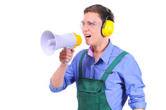 Business. Construction worker shouting into megaphone. Isolated on a white background Royalty Free Stock Images