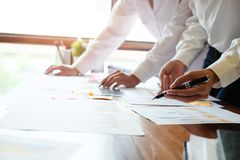 Business consult meeting on wooden table. About Business consult meeting working on wooden table Stock Photography