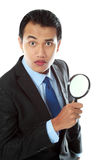 Business consultant. Portrait of asian business consultant holding a magnifier glass Stock Photo