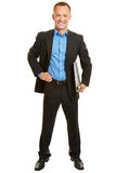 Business consultant in suit with files. Smiling full body business consultant in suit with files isolated on white Royalty Free Stock Images