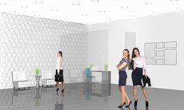 Business consultants. Beautiful businesswoman consultants standing at the office Stock Photo