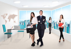 Business consultants. Group of business consultants standing at office Royalty Free Stock Photo