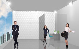 Business consultants. Group of business consultants standing at office Royalty Free Stock Photos