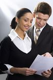 Business consulting. Man and woman in the suits examin the documents Stock Photo
