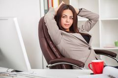 Business consulting. Ambitious businesswoman talking by phone at. Modern office workplace, having coffee Stock Photography