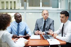 Business consulting. Confident coach giving advice to his colleague at briefing and explaining his ideas stock photos
