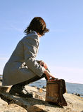 Business contemplation. Businesswoman taking a break by the seaside Stock Images