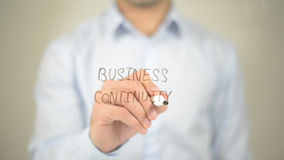 Business Continuity , man writing on transparent screen. High quality stock image