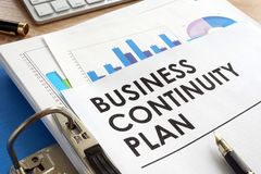 Business continuity plan in a folder. Business continuity plan in a blue folder stock photo