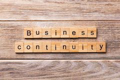Business Continuity word written on wood block. Business Continuity text on wooden table for your desing, concept.  stock photos