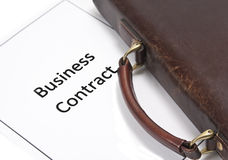 Business Contract and bag. A page of business contract and a businessman bag Stock Photography
