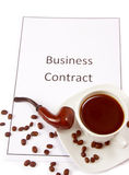 Business contract with a cup of coffee and pipe Stock Photos