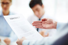 Business contract in hand Stock Photography