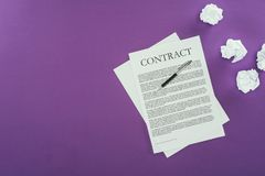 Business contract with pen on purple surface. Top view of business contract with pen on purple surface Royalty Free Stock Photo