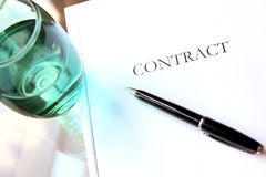 Business contract with pen is ready to sign. A glass of water.  stock images