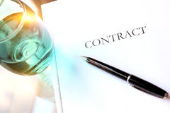 Business contract with pen is ready to sign. A glass of water. Business contract with pen is ready to sign stock image
