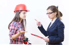 Business controversy. Two business women in a serious contradiction Royalty Free Stock Photo