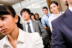 Business convention. Image of confident people presenting at conference and listening to lecture Stock Images