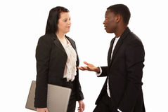Business conversation. Two mixed race business people in conversation Royalty Free Stock Photos