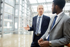 Business Conversation of Partners in Modern Hall Royalty Free Stock Photo