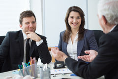 Business conversation. Three entrepreneurs during business conversation Stock Photo