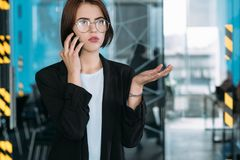 Business conversation troubleshooting worker phone. Serious business conversation. Troubleshooting and time management. Young office worker talking on phone royalty free stock images