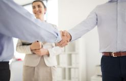 Close up of businessmen making handshake at office royalty free stock photography