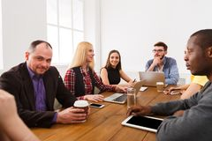 Business meeting. Young team in modern office royalty free stock image