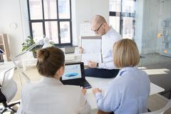 Business team discussing charts at office stock photography