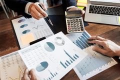 Business Corporate team brainstorming, Planning Strategy having a discussion Analysis investment researching with chart at office stock photo