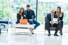 Business Corporation Organization Teamwork Concept. Group of young business people working on project in pairs Royalty Free Stock Photo