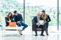 Business Corporation Organization Teamwork Concept. Group of young business people working on project in pairs Royalty Free Stock Photography