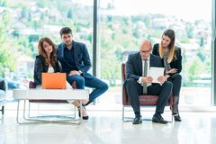 Business Corporation Organization Teamwork Concept. Group of young business people working on project in pairs Royalty Free Stock Images