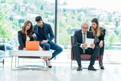 Business Corporation Organization Teamwork Concept. Group of young business people working on project in pairs Stock Photography