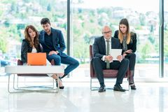 Business Corporation Organization Teamwork Concept. Group of young business people working on project in pairs Royalty Free Stock Image