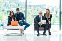 Business Corporation Organization Teamwork Concept. Group of young business people working on project in pairs Stock Photo
