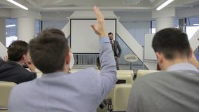 The business couch asks people who wants to be successful during the training and to raise their hands. stock video footage