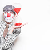Business Countdown Clown Holding Deadline Timer Royalty Free Stock Photography