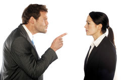 Business couple. Looking at each other angrily Stock Images