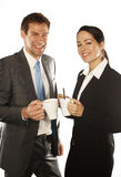 Business couple. Young business couple standing on white background holding a mugs caffe Stock Photography