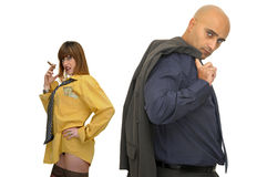Woman smoking in tie and man with suit coat Stock Photo