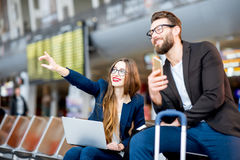 Business couple at the airport Royalty Free Stock Image