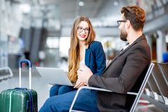 Business couple at the airport Stock Photos