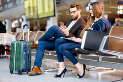 Business couple at the airport Royalty Free Stock Images